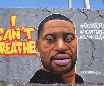 """Graffiti-Gemälde von George Floyd an der Berliner Mauer mit der Aufschrift """"I can't breathe"""""""